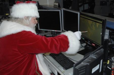 Santa-Inspecting-Santa Cams at NORAD-Santa Tracker headquarters