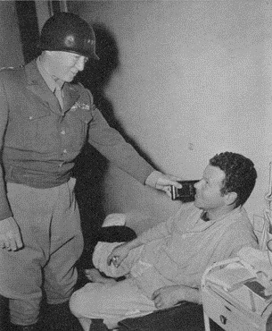 Lt. General George S. Patton visits the US Army 12th Evacuation Hospital (MASH) to award decorations to the World War 2 wounded. (Photo courtesy U.S. Army Medical Department, Office of Medical History)