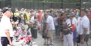 A man looks at the Vietnam Veterans Memorial on Memorial Day 2013: Image source nps.gov