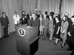 President Lyndon B. Johnson and Vista volunteers. Image courtesy of nationalservice.gov