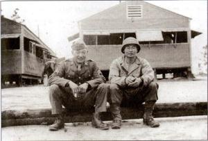 Victor (left) and Johnny Akimoto (right) at camp Shelby, 1943 (Akimoto Family Collection)