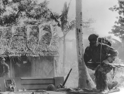 A SEAL scans the surroundings during his unit's intelligence-gathering mission in a Mekong Delta village.